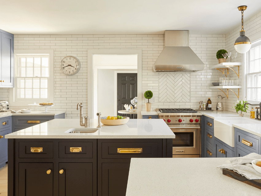 hamptons kitchen black island apron sink elongated subway tile brass finishes darci hether new york