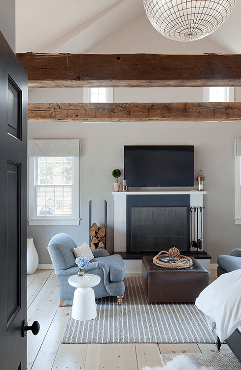 darci-hether-new-york_interior-designer_how-to-update-and-modernize-your-beloved-fireplace_hamptons-master-suite-with-seating-area-and-framed-millwork-and-stone-fireplace