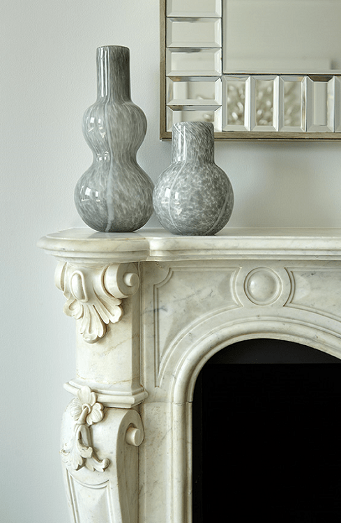 darci-hether-new-york_interior-designer_how-to-update-and-modernize-your-beloved-fireplace_mantle-with-carefully-curated-vase-decor-and-hanging-mirror