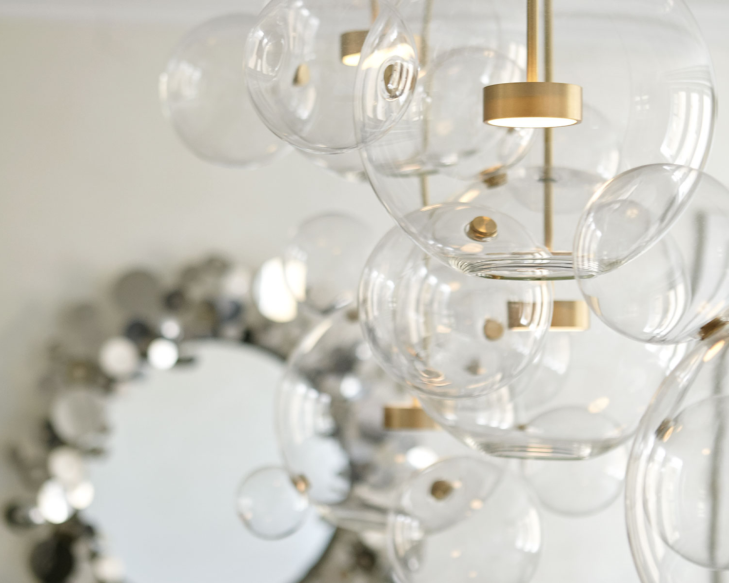 Custom made multi-bubble chandelier in a chic dining room in a NYC interior design project