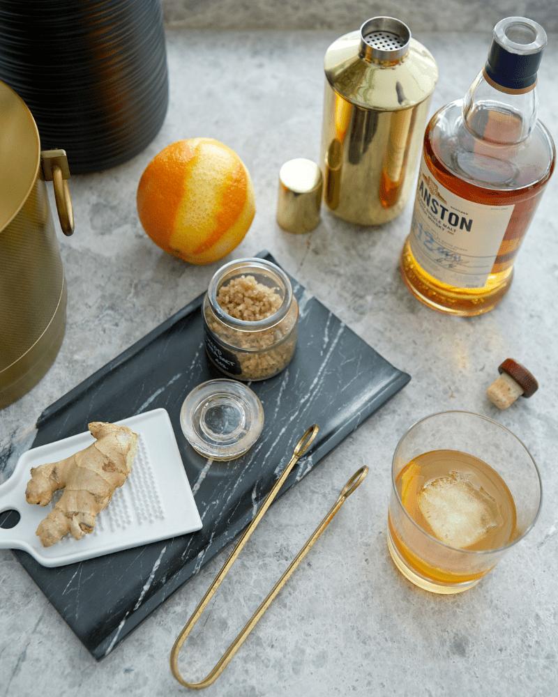 quartz top deanston whiskey orange ginger brass cocktail shaker rocks glass dhny bridgehampton designer