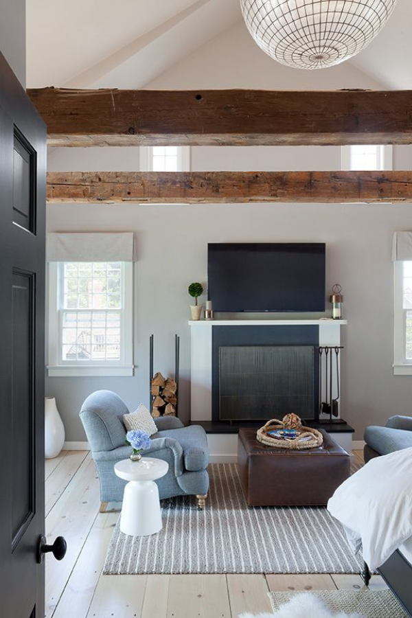 bridgehampton coastal contemporary master bedroom design fireplace sitting area statement lighting dhny